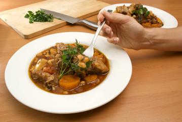 eating lamb stew