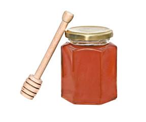 Honey and honey dipper (honey stick) isolated on white backgroun