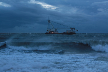 Ship during storm in the sea