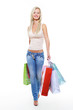 Full-length portrait of  walking woman with shopping bags