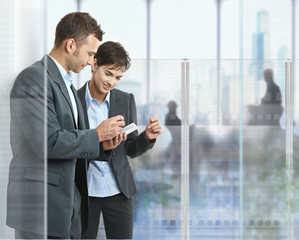 Businesspeople using mobile