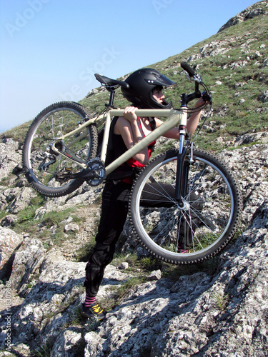 Young woman with mountain bicycle