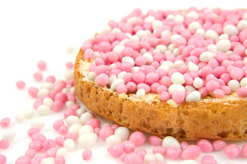Rusk with pink mice over white background