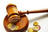 assorted euro coins and a court gavel