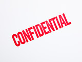 Red confidential stamp on white poster