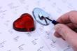 main avec stesthoscope et coeur
