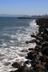 Beach Rocks Leading to a Pier in San Francisco