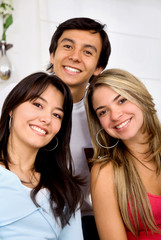 man and two girls smiling
