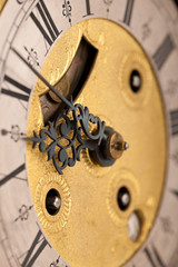 Detail of antique clock with Roman numeral