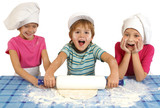 Messy children preparing dough poster