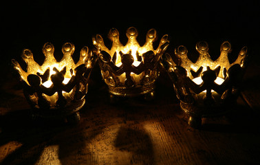 Three Crown candles still life portrait