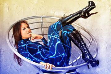 Futuristic girl in fashion chair.