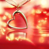 Golden heart on blazing red background poster