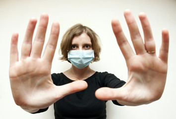 Woman with medical mask protecting against swine flu