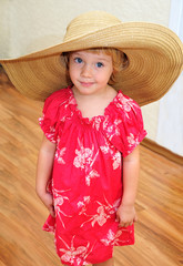 funny girl wearing huge hat