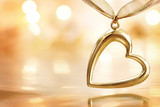 Golden heart on blazing defocused lights background poster