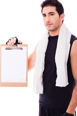 Fitness Man showing a blank clip board