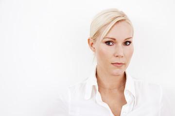 Blond businesswoman on white