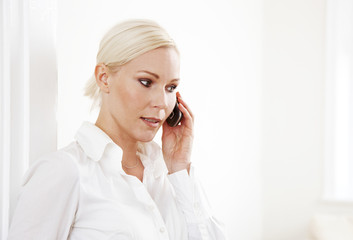 Blond business woman on phone