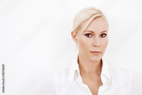 Blond businesswoman on white