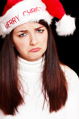 Sad woman in christmas hat