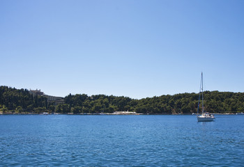 Sailboat in Brilliant Blue Bay