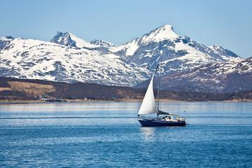 Sailboat and rocky coast