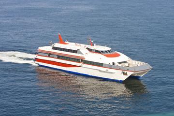 Orange and White Ferry on Blue