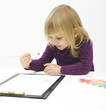little girl, painting with poster paints on the clipboard