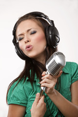 amazing beautiful girl with professional studio microphone and h