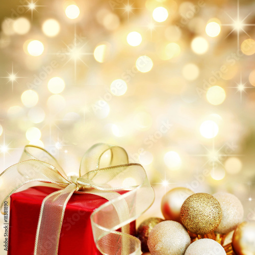Christmas gift and baubles on defocused lights background - 18381890