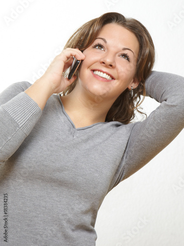 young beauty calling with her cell phone
