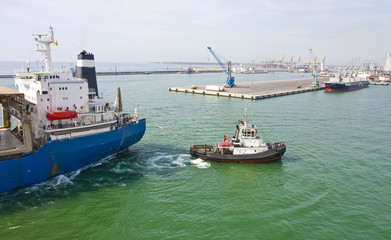 Small Tugboat and Large Ship