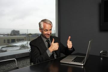 Executive doing OK sign