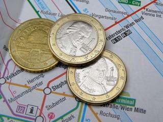 Austrian Euro coins over Vienna underground map