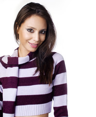 Woman wearing stripe sweater with matching color scarf