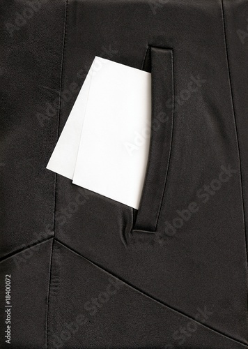 white paper in the pocket of black cloak Poster