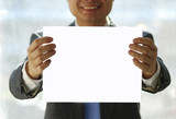 A gentleman holding an isolated white paper poster