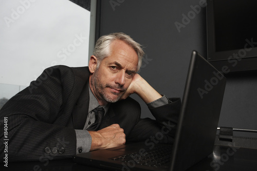 Tired executive with his computer