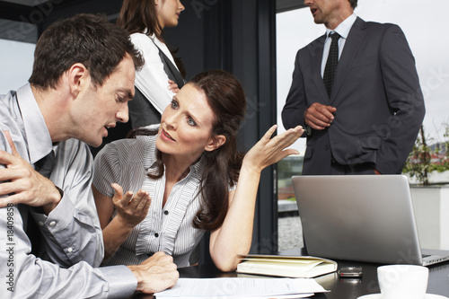 Business woman speaking to a younger man