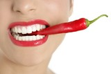 Fototapety Beautiful woman teeth eating red pepper