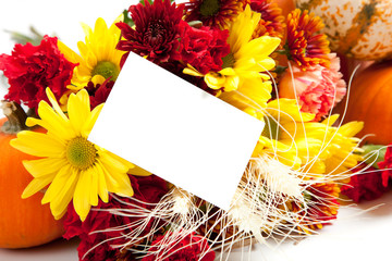 Autumn floral arrangement on white with a note back