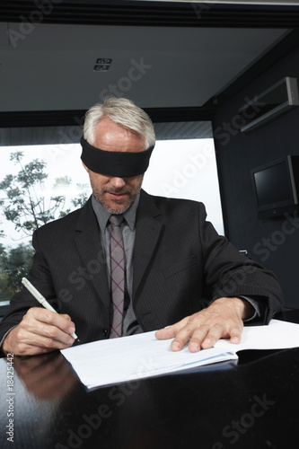 Senior man signing a contract