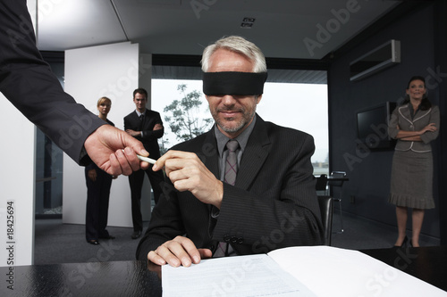 Middle aged man signing a contract