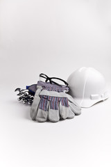 vertical center hard hat leather gloves safety glasses wrenches