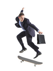 A businessman with skateboard jumping