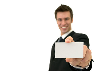 Isolated smiling young man showing a business card