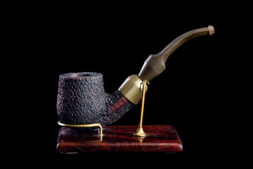 Tobacco pipe isolated on Black background.