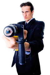 businessman aiming by drill