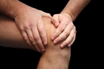 Young man having knee ache
